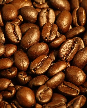 A pile of coffee beans: Trader Joe's Organic F...