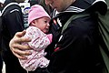 Defense.gov News Photo 101101-N-7103C-192 - U.S. Navy Petty Officer 3rd Class Matthew Sandlin holds his newborn daughter for the first time after being underway for six months aboard the.jpg
