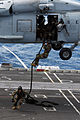 Defense.gov News Photo 110707-N-WW409-218 - Sailors assigned to Explosive Ordnance Disposal Mobile Unit 5 participate in a fast rope exercise aboard the aircraft carrier USS George Washington.jpg