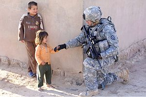 Iraq War order of battle, 2009 - A U.S. Army soldier from the 25th Infantry Division with Iraqi children in March 2009.