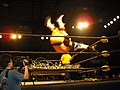 Devon Moore hits the driver from the top rope on Drake Younger on a barbed wire board in CZW.jpg