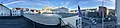 Distorted (compressed) panorama of Leirvik, Stord, Norway, seen from Grand Hotell. Roof tops, antennetårn radiolinjetårn (radio mast tower), Hagerupshuset, Bytunet, cars in Osen, car park, taxis etc. 2018-03-10.jpg