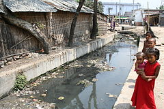 This drain is used to defecate and urinate in a community in Bangladesh