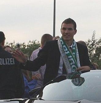 Edin Džeko - Džeko as winner of Bundesliga with Wolfsburg in 2009.