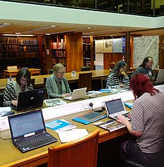 Photo shows people using computers in the National Library of Scotland