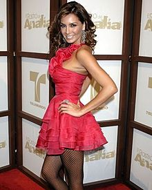 Gutiérrez at a premiere in a pink dress and fishnet stockings