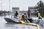 Environmental restoration employees deploy a containment boom190318-F-KS317-006.jpg