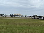 F-35A's and P-51 Mustang (46785674684).jpg