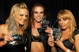Fans of Adult Media and Entertainment Award - Alexis Texas, Tori Black and Lexi Belle displaying their trophies backstage at the F.A.M.E. Awards in 2010