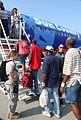 FEMA - 37748 - Residents getting on an airplane to evacuate Louisiana.jpg