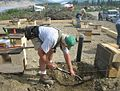 FEMA - 41667 - Volunteer works on a home foundation in Alaska.jpg