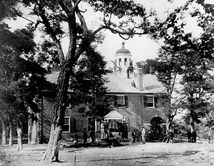 Fairfax Court House, Virginia, with Union soldiers in front and on the roof, June 1863 Fairfax court house during the Civil War.jpg