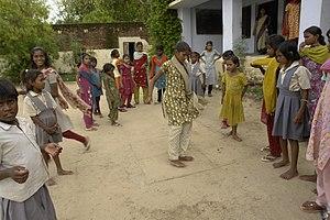Girls playing hopscotch, Jaura, M.P., India.