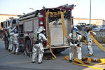 Firefighters rescue mock victim during bug-out 140211-F-FM358-325.jpg