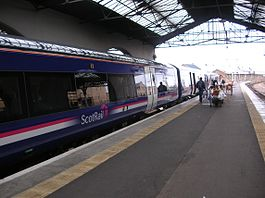 A Class 170 Turbostar train in First ScotRail livery at Inverness