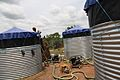Flickr - DFID - UK Department for International Development - ICRC providing clean drinking water at a refugee camp in Liberia.jpg