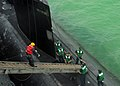 Flickr - Official U.S. Navy Imagery - Sailors assigned to USS Frank Cable and the submarine USS Hampton raise the brow to get Hampton underway.jpg
