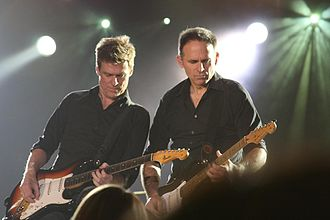 Bryan Adams discography - Adams (left) and his guitarist, Keith Scott (right) on March 13, 2009 in Peterborough, Ontario, Canada