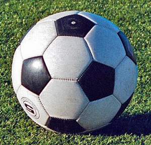 Sports equipment - Adidas Telstar-style ball, with the familiar black and white truncated icosahedron pattern.