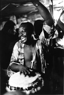 Frisner Augustin drums for a Vodou dance in Brooklyn, early 1980s.jpg