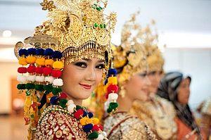 Malay Indonesian - A Palembangese Malay girl clad in the Gending Sriwijaya costume.