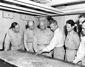 Roy Geiger - Geiger (third from left) and III MAC staff during the planning of Okinawa operation. From left to right: David R. Nimmer, Walter A. Wachtler, Geiger, Merwin H. Silverthorn, Sidney S. Wade, Francis B. Loomis Jr. and Gale T. Cummings.