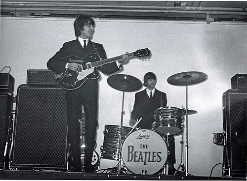 Harrison (left) and Ringo Starr (right) performing at the King's Hall in Belfast, 1964 George Harrison and Ringo Starr, King's Hall, Belfast 1964 (18226096790).jpg