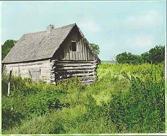 George T. Inkster - Inkster's 1878 log cabin in the vicinity of what would become Inkster, North Dakota. Photograph taken in the 1910s.