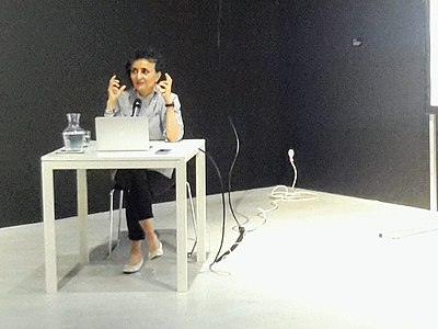 Ghada Amer at a conference in Tours (France) in 2018