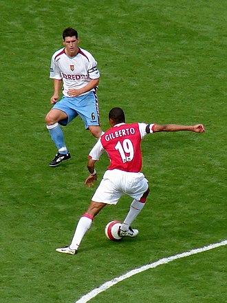 Gilberto Silva - Gilberto (right) faces up to ex-Aston Villa captain Gareth Barry