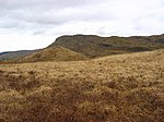 Glacial deposits Cone shaped hills show where streams beneath or upon glaciers formed waterfalls depositing gravels. In folklore they are the homes of fairies. Rather tussocky bog.