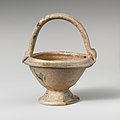 Glass bowl with basket handle MET DP108422.jpg