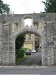 Wall around grounds of Glastonbury Abbey and Abbey Retreat House, including the gate way on Chilkwell Street