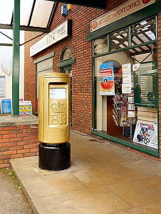 Eccleston, Lancashire - The post box painted gold to celebrate resident Bradley Wiggins' gold medal at the 2012 Summer Olympics