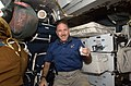 Grunsfeld Poses for a Photo on the Shuttle Atlantis Middeck (27561530993).jpg