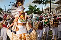 Guadeloupe winter carnival, Pointe-à-Pitre parade. A group of young performers. Foreground- woman wearing traditional carnival outfit (photo reportage ).jpg
