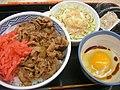 Gyudon, potato salad and raw egg by jetalone in Ochanomizu, Tokyo.jpg