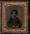 Half-length portrait, young boy. Cased tintype, ninth plate.jpg