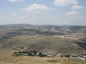 Tuqu' - General view of the vicinity. The Israeli settlement  of Tekoa is situated in the front, while Tuqu' is seen directly behind and the left of the settlement. To the right is the village of Khirbet al-Deir, part of the Tuqu' municipality.