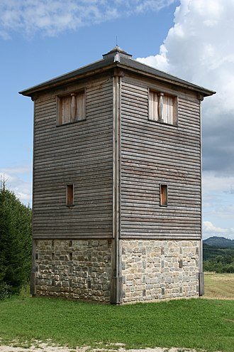 "Castra - Reconstruction of the specula or vigilarium (Germanic burgus), ""watchtower"", a type of castrum, of Fectio. An ancient watchtower would have been surrounded by wall and ditch."