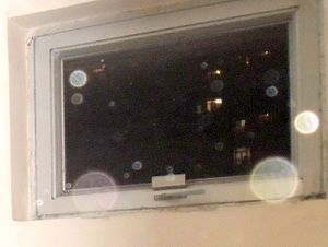 Orb (optics) - Orbs caused by dust.