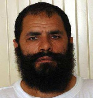 "Mohammad Fazl - Mohammed Fazl's Guantanamo identity portrait -- the white uniform shows he is considered ""compliant"""