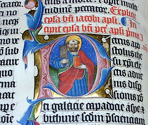 Historiated initial - The letter P as a historiated initial (depicting Peter) in an illuminated Latin bible, 1407 AD. Colored with paint and gold leaf