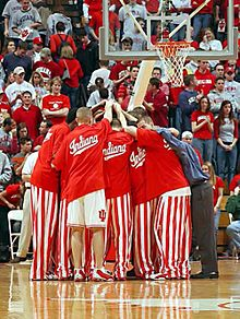 reputable site 9e7c4 99d71 Indiana Hoosiers - Basketball players huddle before a game in their iconic  candy striped pants