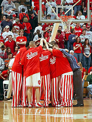 Indiana Hoosiers - Basketball players huddle before a game in their iconic candy striped pants