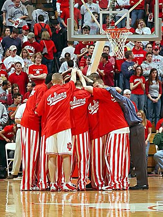 Indiana Hoosiers men's basketball - Players huddle before a game in their iconic candy striped pants