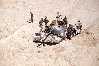 Division Daguet - French and American soldiers inspecting an Iraqi Type 69 tank destroyed by the French Division Daguet during Operation Desert Storm.
