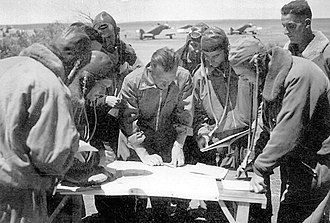 Italian pilots of the Regia Aeronautica in Egypt study a map (September 1940). Italian pilots studying a map in Egypt (Sept 1940).jpg