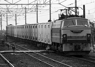 JNR Class EF66 - EF66 20 hauling an express freight train formed of ReSa 10000 refrigerated vans in 1985