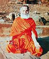 Rāmabhadrācārya meditating on the banks of Mandakini river during a Payovrata. He is seated in the Sukhasana pose with fingers folded in the Chin Mudra.